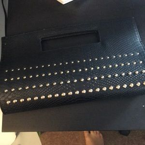 Black clutch purse with gold studs